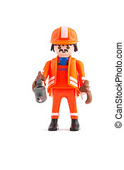 oil worker - plastic construction worker with oil can in his...