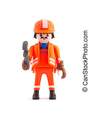 construction - plastic construction worker holds gaspipe...