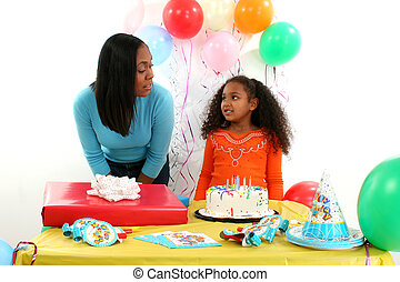 Birthday Party - Mother and daughter at birthday table.