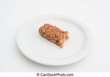 Half eaten snack bar on a plate