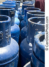 Propane Canisters - Photo of a line of blue propane...