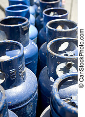Blue Propane Tanks - Photo of a line of blue propane tanks