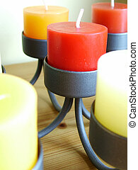 Coloured candels - Multi coloured candels in a candlestick...