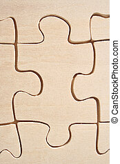 Wooden jigsaw piece - One wooden jigsaw piece close-up