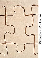 Wooden jigsaw piece - One wooden jigsaw piece close-up