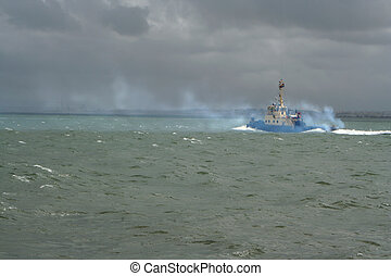 engine trouble - tugboat polluting the air