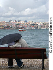 romantic rain - Couple enjoy the view of Lisbon from...