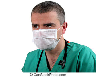 ICU doctor with mask looking with attention in a directionto...