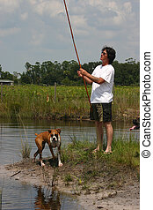 Fishing with Friends - Man fishing with his boxer dog