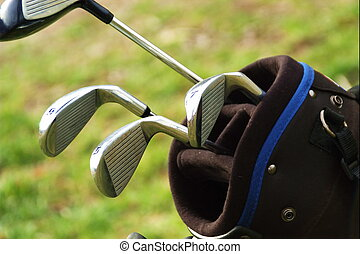 some clubs - close up of golf clubs in golf bag