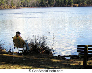 Solitude - Sitting in the shade on a hot day, fishing, in...