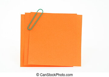 three post-it notes with green paperclip