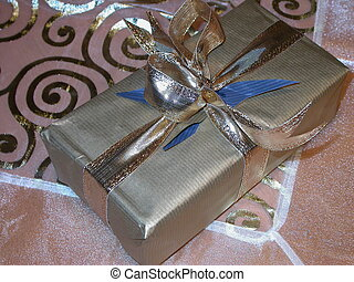silver present - present wrapped in silver paper and ribbon