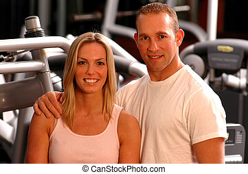 couple in gym - good looking couple in fitness center gym