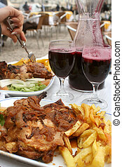 chicken dinner - chicken,french fries and sangria at an...