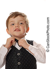 Dessing up - boy fixing bow tie