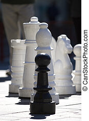 Feeling Like a Pawn - A single black pawn being overshadowed...
