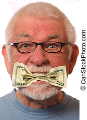 Put $ where mouth is - Man with money in mouth signifying...