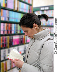 Student in the library - Close up of a student reading a...