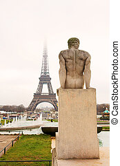Paris 40 - A statue in the foreground with the Eiffel Tower...