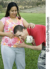 Young family - Pregnant woman letting boyfriendhusband...