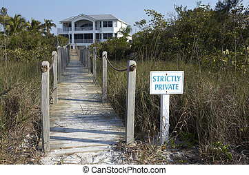 Private entrance to a beach front property on Sanibel beach,...