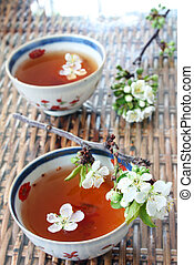 Chinese Tea - Tea and blossom with antique bowls