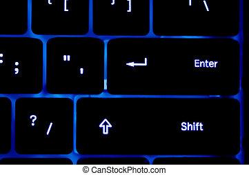 Blue neon Keyboard in a dark area