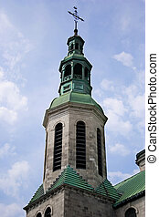 Church steeple against a beautiful blue sky in Quebec