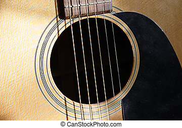 6 string guitar - the sound hole and finger board of a 6...