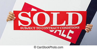 Contract agreed - A real estate sign with sold strip added...