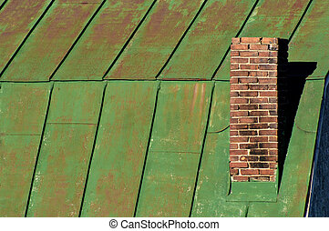Chimney on green barn roof, horizontal