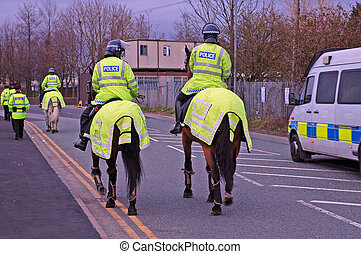 Police Horses and riders with other police officers in the...