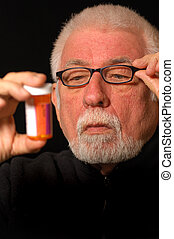 Reading Fuzzy Pill bottle - Older man tries to read pill...