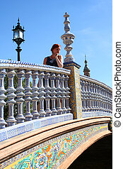 Historic buildings 3 - Woman on bridge at Plaza de Espana in...