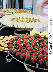 Catered party - Chocolate dipped strawberries and finger...