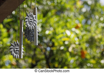 Sun-Chimes - Weathered and well-used Sun-shaped windchimes