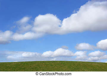 Simple Horizon - Grass hillside against a blue sky of...