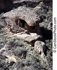 Eroded Boulder House in a desert canyon on the Colorado Utah...