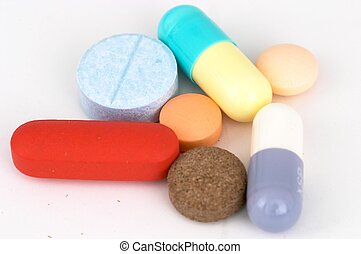 Assorted Pills - Closeup of Assorted Pills and Capsules on...