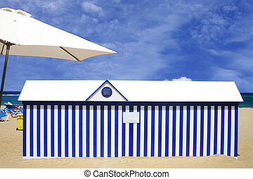 Beach Scene - Beach hut with umbrella