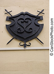 placard - decorative iron crest on the exterior of a...