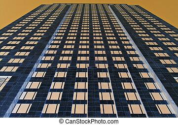 Golden office tower - City office towerblock under a golden...
