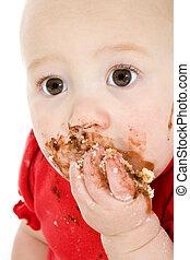 Baby Eating Cake - Baby eating cake, making mess on face