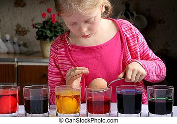 Easter eggs - Little girl coloring easter eggs
