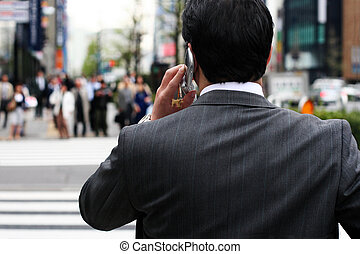 Business man - Businessman talking on the phone on the...