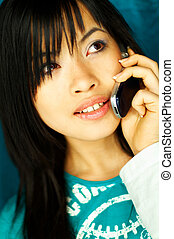 Girl talking cell - Sexy young asian girl talking cell phone