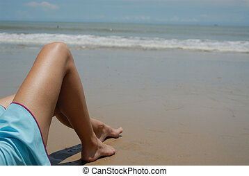 Stock photo of beautiful tall brunette woman on the beach in...