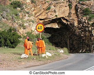 The workers - Workers in South Africa, trying to fix a sign