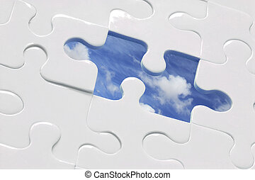 Blue Sky Jigsaw - White jigsaw with piece missing and sky...